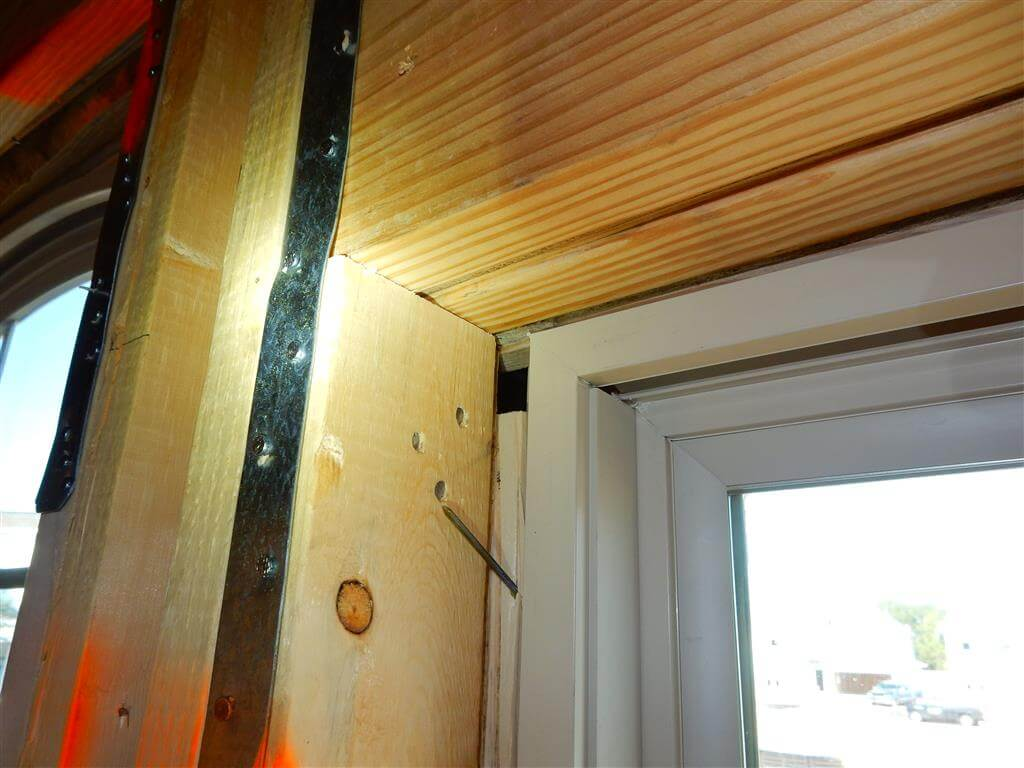 Window improperly installed over furring strips. Viewed from inside.