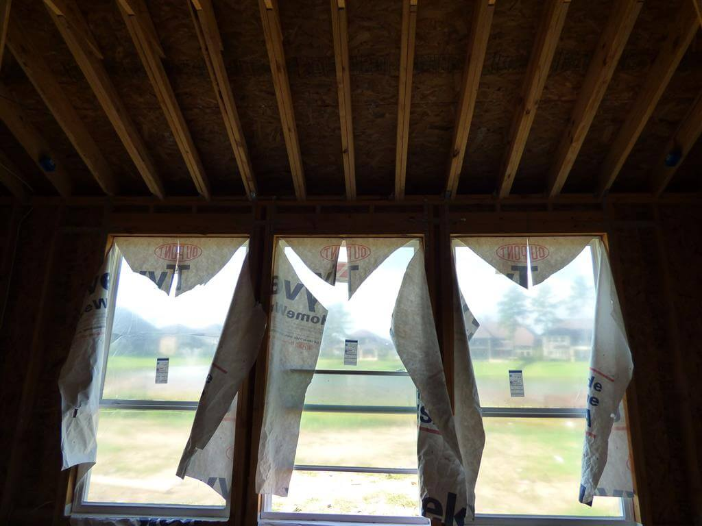 This window is not properly integrated with the water-resistive barrier/drainage plane. The upper flap of the house-wrap should be on the outside.