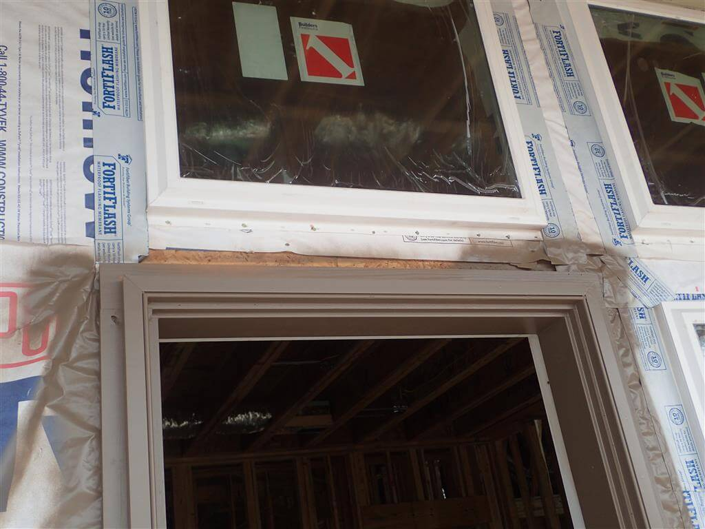 This window is not properly integrated with the water-resistive barrier/drainage plane.